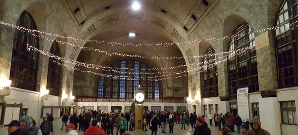 Visitors on the grand concourse of Buffalo Central Terminal. The station saw its first holiday tree lighting event since the 1970s on Saturday as part of a local citizens campaign to re-establish rail passenger service at the facility. (Photos by Terry Duffy)
