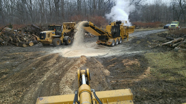 The wood chipper, shown in action at Como Lake Park.