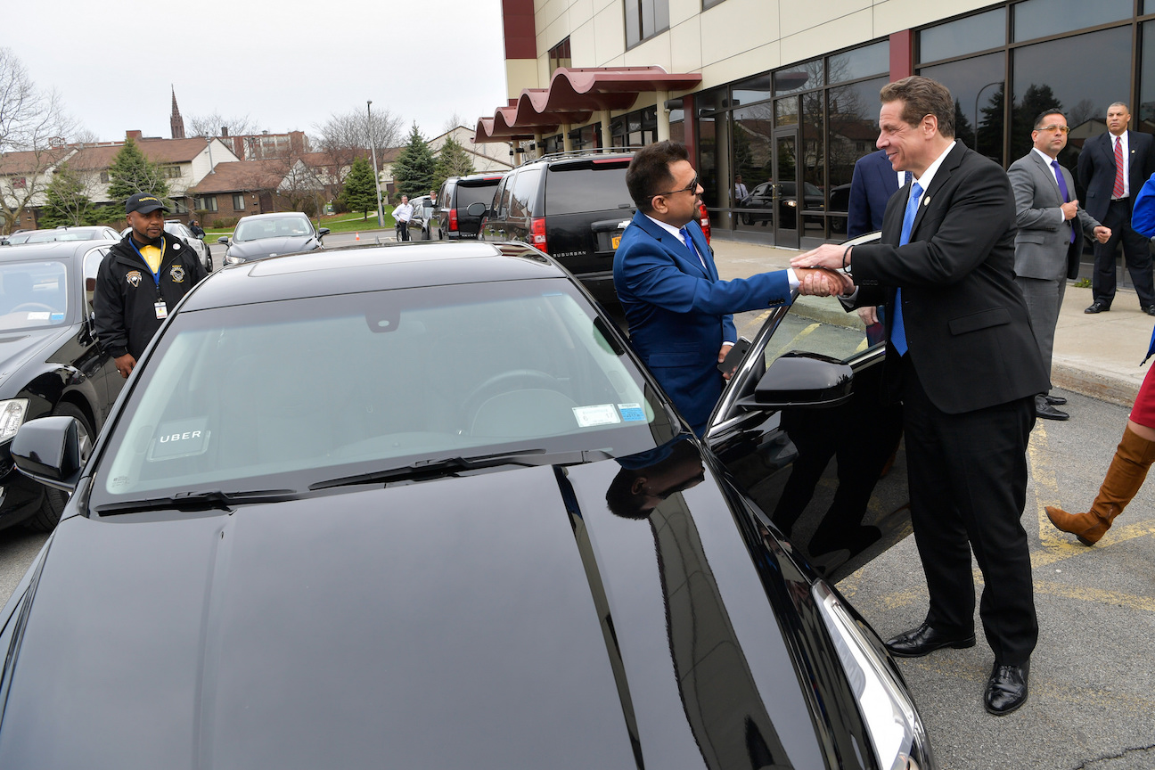 Gov. Andrew M. Cuomo, right, signed and announced highlights of the passed 2017-18 executive budget in Buffalo on Tuesday. It included ride sharing, the Middle Class Recovery Act and Excelsior Scholarship Program. The governor arrived at event in first Uber ride in upstate New York. (Photo courtesy of the governor's Flickr page)