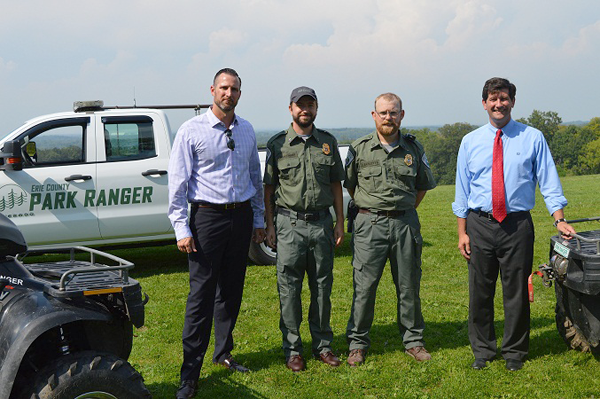 Pictured, from left, Erie County Parks Commissioner Troy P. Schinzel, Park Ranger Brian Siklinski, Supervising Park Ranger Chuck Bartlett and Erie County Executive Mark C. Poloncarz are surrounded by ranger vehicles at Chestnut Ridge Park. Not pictured: Park Ranger Jerry Krajna.