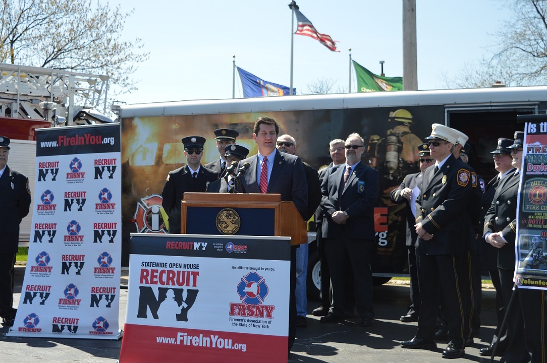 Erie County executive Mark C. Poloncarz (at podium) is surrounded by volunteer firefighters from Doyle Hose Company No. 1 in Cheektowaga, as well as representatives of the Firemen's Association of the State of New York, to kick off the seventh annual Recruit NY campaign with a call for volunteer firefighters to join the ranks of those already serving their communities across Erie County.