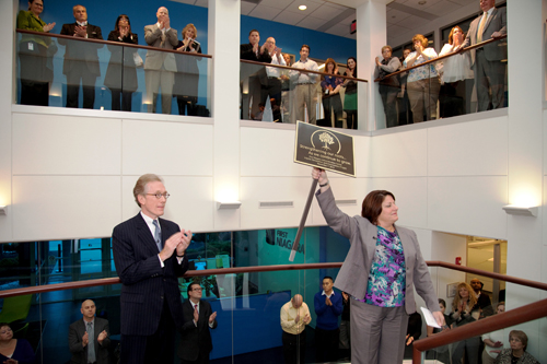First Niagara Interim President and CEO Gary M. Crosby joins Julie Signorille, First Niagara managing director of operations, at a celebration of the company's newly renovated administrative center in Lockport.