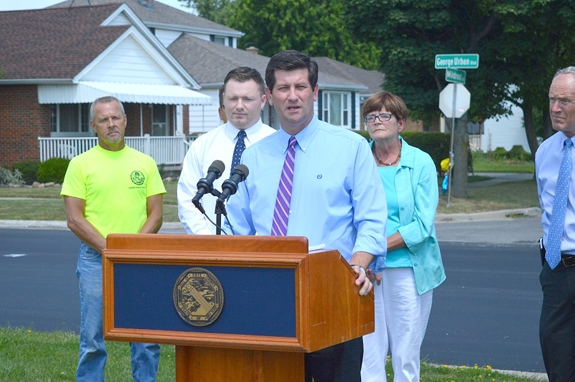 Erie County Executive Mark C. Poloncarz (at podium) is joined by Erie County Legislator Patrick Burke, Town of Cheektowaga Supervisor Mary Holtz and members of the Erie County and Town of Cheektowaga departments of public works to discuss George Urban Boulevard in Cheektowaga.