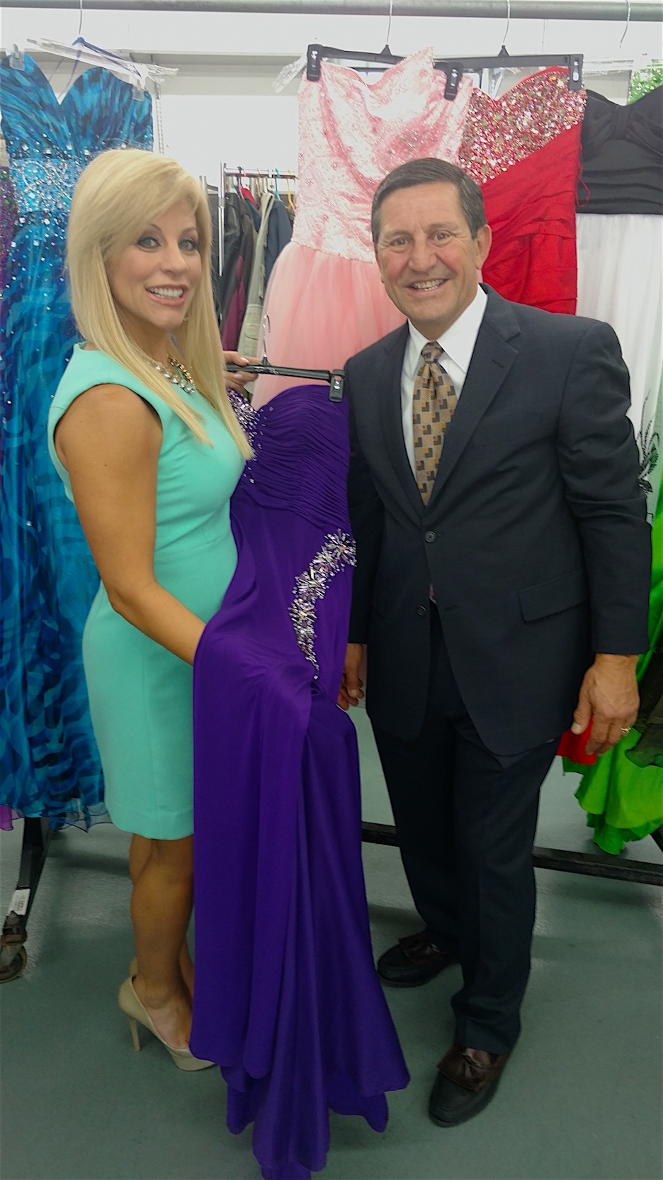 Janet Snyder, left, voice of `Gowns for Prom,` poses with Paul Billoni, owner and president of Colvin Cleaners.