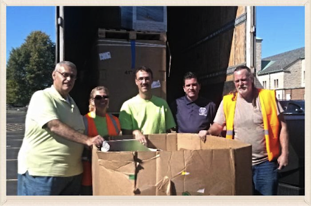 State Sen. Mark Grisanti, second from right, and co. collected items for recycling on Saturday.