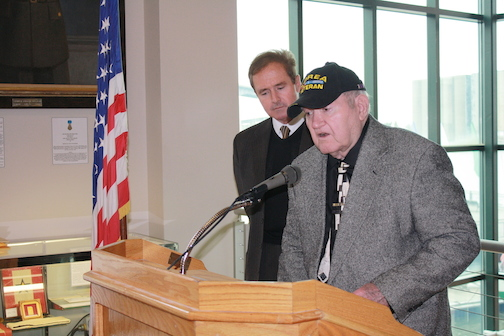 Eugene `Bob` Pernatt speaks as Brian Higgins listens.