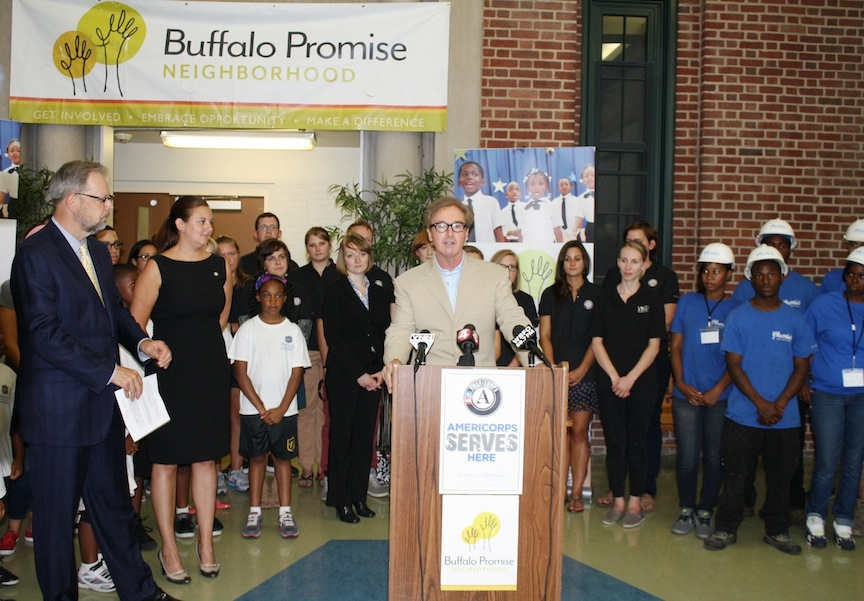 Congressman Brian Higgins, The Service Collaborative Executive Director Kate Sarata and Buffalo Promise Neighborhood CEO David Chamberlain are joined by Westminster Community Charter School students and AmeriCorps and YouthBuild members.