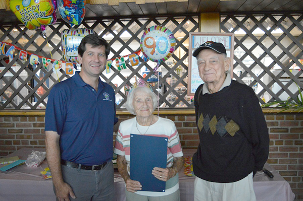 Erie County Executive Mark C. Poloncarz joins Jean Rainbow and her husband, Al, at Elma Meadows to proclaim `Jean Rainbow Day` in Erie County. Below, Poloncarz (center, rear) joins members of the Elma Meadows Women's Golf Club for a surprise birthday celebration.