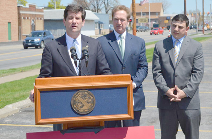 Pictured, from left: Erie County Executive Mark C. Poloncarz (at podium) is joined by Congressman Brian Higgins and Erie County Legislator Peter Savage (3rd District) to announce upcoming road repairs on Kenmore Avenue. Phase three of the project is slated to begin in mid-May and will involve road repairs on the stretch of Kenmore Avenue between Main Street and Klauder Road.