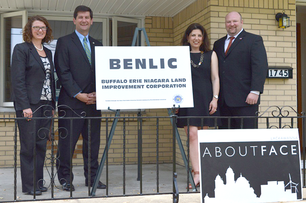 Deputy Erie County Executive Maria Whyte, Erie County Executive Mark C. Poloncarz, BENLIC Executive Director Jocelyn Gordon and City of Lackawanna Mayor Geoffrey Szymanski gather on the front porch at 1745 Abbott Road in Lackawanna. The home, which had stood empty and in disrepair for several years, was acquired by the land bank and rehabilitated for resale.