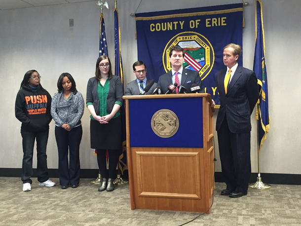 Erie County Executive Mark C. Poloncarz (at podium) was joined by Congressman Brian Higgins (right) and representatives of the WNY Law Center and PUSH Buffalo to add his voice in opposition to the proposed acquisition of First Niagara Financial Group by KeyCorp.