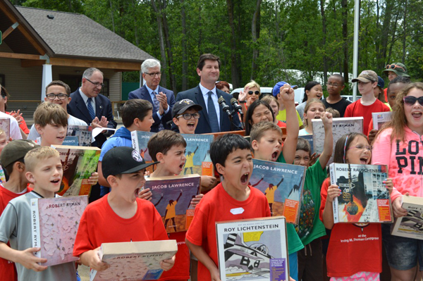 Erie County Executive Mark C. Poloncarz (at podium) is joined by Commissioner of Social Services Al Dirschberger, Erie County Legislator Tom Loughran (applauding) and campers at Camp Centerland as he announces the return of summer `Prime Time` grants to assist organizations serving youth.