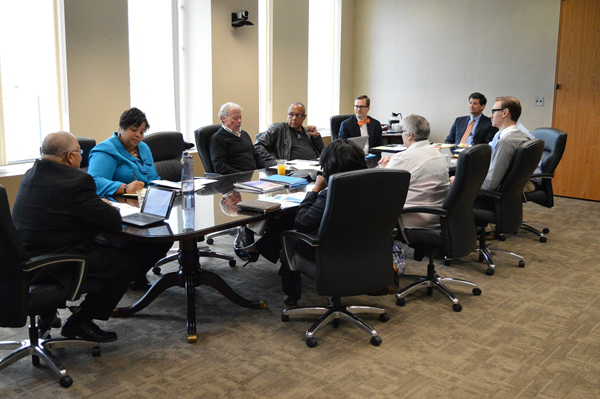 Erie County Executive Mark C. Poloncarz (seated at right of table) joins members of the poverty committee as the group came together for its inaugural meeting. The volunteer, seven-member committee will advise Erie County government on measures to reduce poverty and its causes.