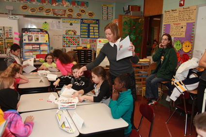 Elizabeth Gurney, executive director of the First Niagara Foundation, teaches students about financial literacy.