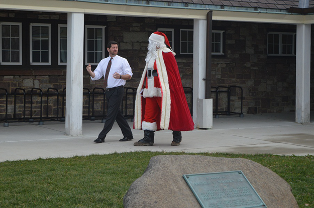 Erie County Executive Mark C. Poloncarz joins Santa Claus for a walk outside the casino at Chestnut Ridge Park on Thursday. The Jolly Old Elf will be setting up shop this weekend at the park with the return of `Santa Land.`