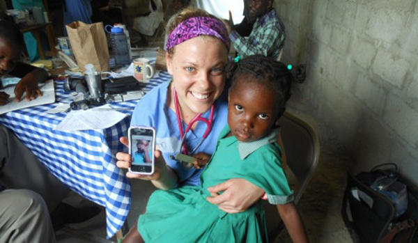 Ellen Tokarz, a second-year medical student at UB, poses with one of her patients at the clinic in Fontaine, Haiti.