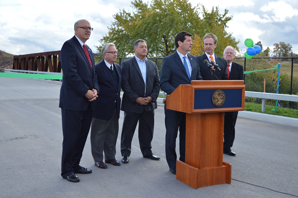 Erie County Executive Mark C. Poloncarz is flanked by elected officials at the opening of the North Youngmann Commerce Center in Tonawanda. Erie County's newest industrial park, the commerce center will attract new business and help businesses already located in Erie County to stay and grow locally. Erie County has invested more than $2.5 million in the site for necessary road and infrastructure improvements.