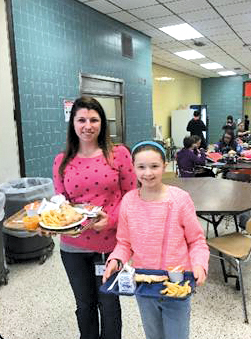 Assistant Principal Danielle Wallenhorst Hawkins goes to lunch shadowing sixth-grader Savanna.