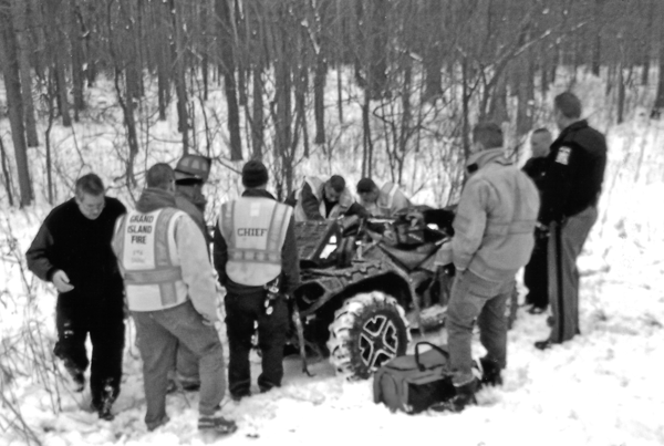 An operator of an all-terrain vehicle was removed from the ditch and readied for transport to a hospital Monday. (Photo by Ray Pauley)