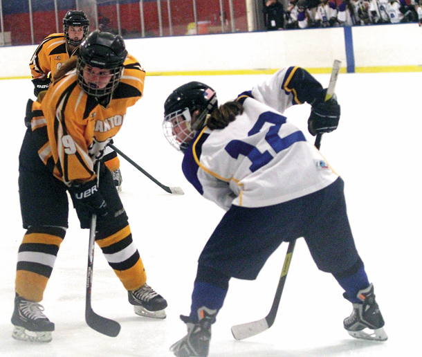 Grand Islander Abby Blair faces off against Canton's Mary Kait Mace during the state championship semifinal Friday in Albany. (Photo by Janet Schultz)