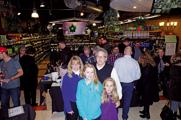 Kim and Sam Aceti and their daughters Melina and Marissa celebrated a 10th year anniversary Dec. 2 at their business, Aceti's Wine & Spirits. (Photos by Larry Austin)