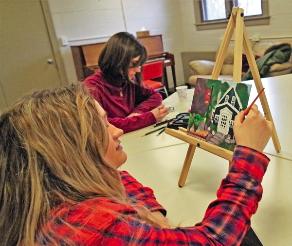 Alexa Mallare works on a painting of the Village Inn, owned by her uncle, Mike Carr, and where her mother works. She finished the painting, a gift for a family member, Saturday while at the new art studio in the Nike Base Park.