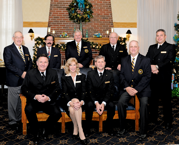 Newly elected 2016 officers and directors of the Buffalo Launch Club were announced by BLC General Manager Timothy Pike. They are, from left, front row, seated: James Kalec, vice commodore; Rhonda Ried, commodore; John Tommasulo, rear commodore; Carl Leinweber, fleet captain. Back row, standing: Frank DeGeorge, treasurer; Joseph Marciano, director; Edward Wirth, director; Robert DeGlopper, director; and John Pomaranski, secretary. Not pictured are directors F. Danahy Georger, Paul M. Schneeberger and J. David Specker. The photo was taken at the Buffalo Launch Club, 503 East River Road. (Photo by K&D Action Photo & Aerial Imaging; click to enlarge)