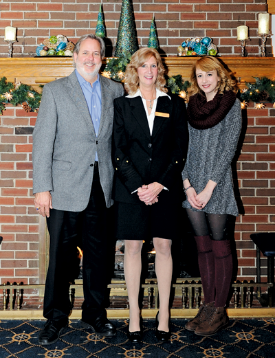 Newly elected Buffalo Launch Club Commodore Rhonda Ried, center, is flanked by her husband, Gregory, and their daughter, Amber, at the BLC. (Photo by K&D Action Photo & Aerial Imaging)