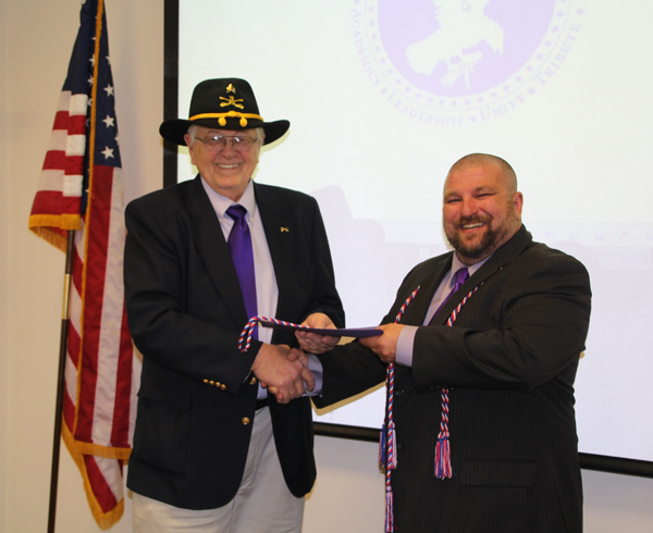 Niagara University professor Bo Pikas was recently inducted into SALUTE, the Veterans honor society. Pikas is a member of the American Legion Post 1346, Grand Island. Pictured, he was inducted by Karl Hinterberger, assistant coordinator of Veteran Services, Niagara University.