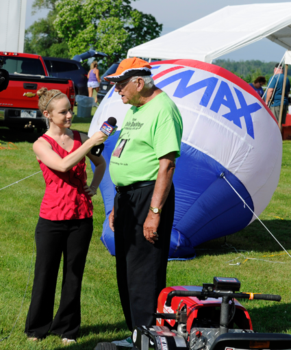 Pictured alongside the action, WGRZ Channel 2 reporter Erica Brecher interviews event founder Floyd Doring.