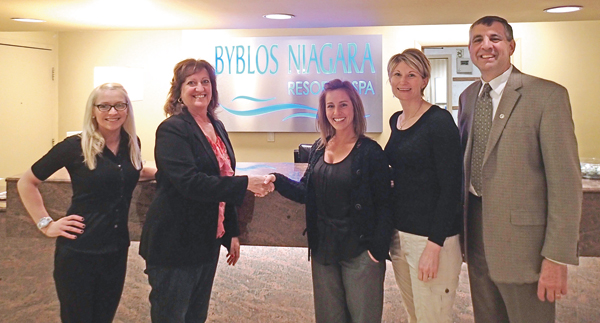 Pictured, from left: Laura O'Donnell of Byblos, Citizen of the Year Chair Liz Wilbert shaking hands with Senior Sales Manager Marni Bator, Citizen of the Year committee assistant Cyndy Montana and Byblos Niagara General Manager Scott Swagler.