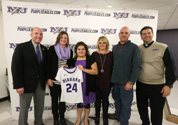 Caralyn Renyolds, center, with family, friends and NU officials.