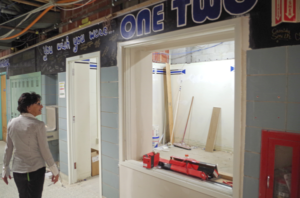 Jane Boyle of Grand Island High School checks out the remodeling on the Casey's Corner school store just off the Viking Mall last Wednesday. (Photo by Larry Austin)