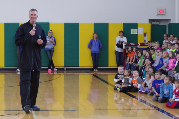 Christian Laettner spoke to students at St. Stephen School during an assembly Oct. 2 in the Monsignor Richard M. Cahill Athletic and Convocation Center. (Photo by Larry Austin)