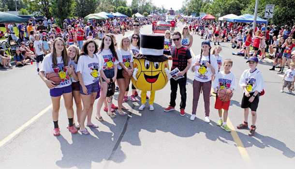 Corey McGowan with Grand Island high School student volunteers and the Gus Macker mascot. His girlfriend, Ellie, is inside the costume.