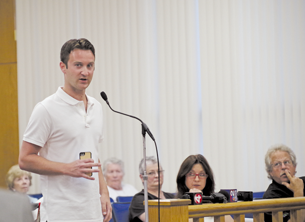Corey McGowan speaks to the Grand Island Town Board on Monday during a public hearing on the Gus Macker 3-on-3 basketball tournament he has planned for Aug. 29-30. The board approved the event by a 3-1 vote. (Photo by Larry Austin)