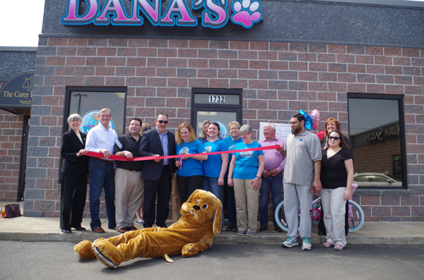 Dana Carver cuts the ceremonial ribbon on her new business location at 1732 Grand Island Blvd. Members of the business community and government leaders were on hand Monday as Carver welcomed the community to the new Dana's Stylin' Pets.