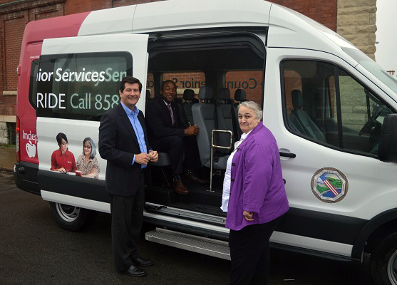 Erie County Executive Mark C. Poloncarz (left) recently joined Erie County Commissioner of Senior Services Timothy Hogues (seated, center) and Executive Director of the Lt. Col. Matt Urban Human Services Center Marlies Wesolowski (right) to present the center with a new van as part of the Erie County Going Places senior transportation program.