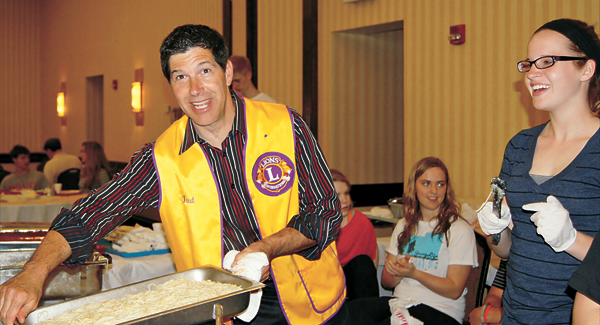 Lion Fred Ruocco serves spaghetti at the annual Grand Island Lions spaghetti dinner fundraiser, held each spring. (Photos courtesy Grand Island Lions Club)