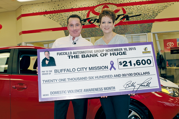 Chris Granholm, general manager, Fuccillo Chevrolet of Grand Island, presents a check for $21,600 to Aubrey Calhoun, associate executive director, Buffalo City Mission, Tuesday as part of the Fuccillo Statewide October Event. Money from new or pre-owned vehicle purchases at Fuccillo dealerships went toward local domestic violence support services. (Photo by Larry Austin)
