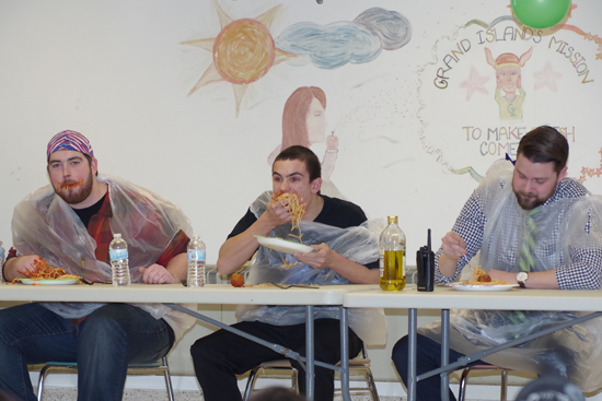 Matt Studley pounds down some pasta during the first-ever spaghetti-eating contest held Tuesday during the Grand Island Rugby Club spaghetti dinner fundraiser. (Photos by Larry Austin)