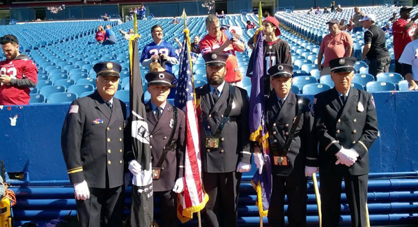 An honor guard from Grand Island Fire Co. had the duty of presenting the colors at the Buffalo Bills home game Sunday. From left: firefighters Pete Coppola, Pat Hahn, Dave Castiglia, Tony Mastantuono Jr. and Tony Mastantuono Sr. (Photo by Greg Butcher)