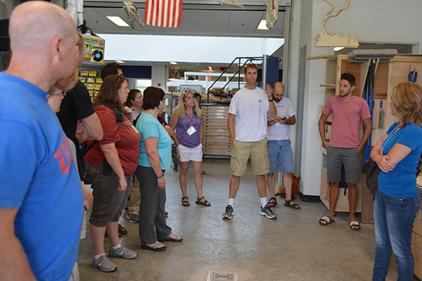Carl Koppman, a technology teacher in the Grand Island Central School District, talks to physics teachers from around the state during a workshop at GIHS as part of the New York State Master Teacher Program. Koppman and GICSD teacher Eric Cohoon (second from right) gave the teachers a tour of the year-old STEM wing at Grand Island High School.