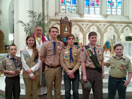 In the group picture, from left: Jonathan Minton, Emily Cohen, Father Sam Venne of St. Stephen R.C. Church, Cade Mongielo, Joseph Peters, Patrick Stouter, and Lucian Bodkin.
