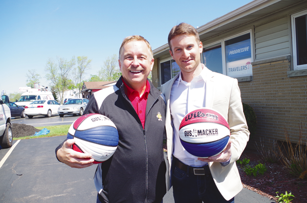Scott McNeal, left, and Corey McGowan, hope to bring the Gus Macker 3-on-3 basketball tournament to Grand Island in August. McGowan, an Island native, introduced McNeal, event founder (and Gus Macker himself) at a news conference on the Island May 14. (Photo by Larry Austin)