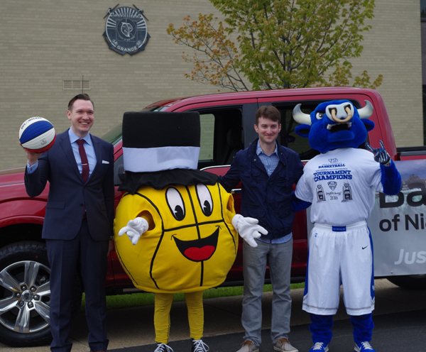 At a press conference Tuesday announcing details about the tourney are, pictured, from left: Grand Island Town Supervisor Nathan McMurray, the Gus Macker mascot, event organizer Corey McGowan, and Victor E. Bull, mascot of the University at Buffalo. (Photo by Larry Austin)