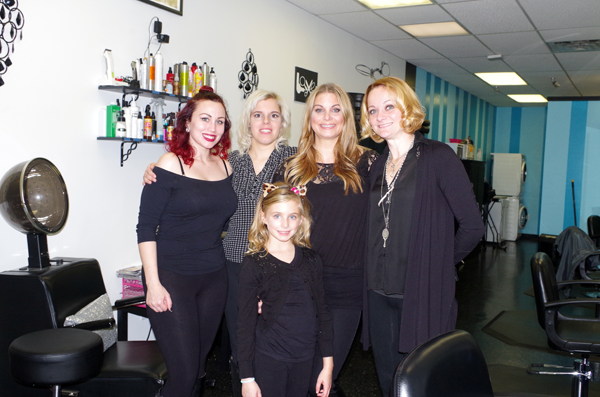 For the second year in a row, Hair Envy Salon provided free haircuts for veterans on Veterans Day. The salon gives veterans a discount all year long as well. The Hair Envy team on Veterans Day included, from left: Jessica Italia, Lexi Wrobel, Cathy Fancher and Christen Snyder. In front is Eden Fancher. (Photo by Larry Austin)
