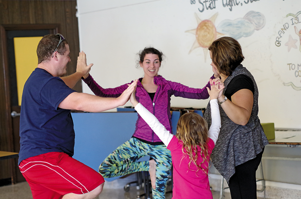 Jeanna Duarte-Schwartz demonstrates the family tree pose on the stage in the large cafeteria. She's a kids yoga instructor with Soma Cura in the Tops plaza. Soma Cura will run a kids camp from July to Labor Day on Wednesdays in the Town Commons. (Photos by Larry Austin)