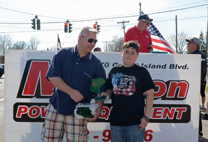 Jonathan Dingey receives first place in the Stock Division from Heath Mazenauer of the Grand Island Lawnmower Racing Series.