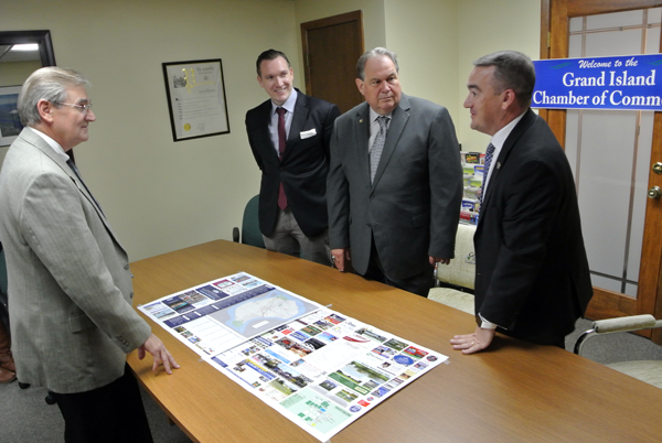 From left, Deputy Town Supervisor and Grand Island Chamber of Commerce First Vice President Jim Sharpe, Town Supervisor Nate McMurray, Assemblyman John Ceretto, and GI Chamber President Eric Fiebelkorn look at a map of the Island as they discuss the proposed new tourist plaza eyed for Alvin Road. (Photo by Larry Austin)